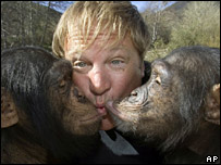 Sid Yost kissing two chimps
